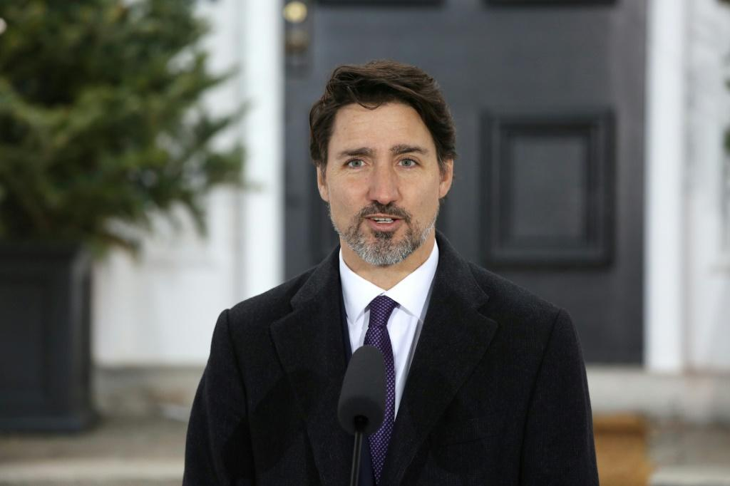 Canadian Prime Minister Justin Trudeau, pictured March 20, 2020, had announced a coronavirus aid package of Can$82 billion (US$57 billion)