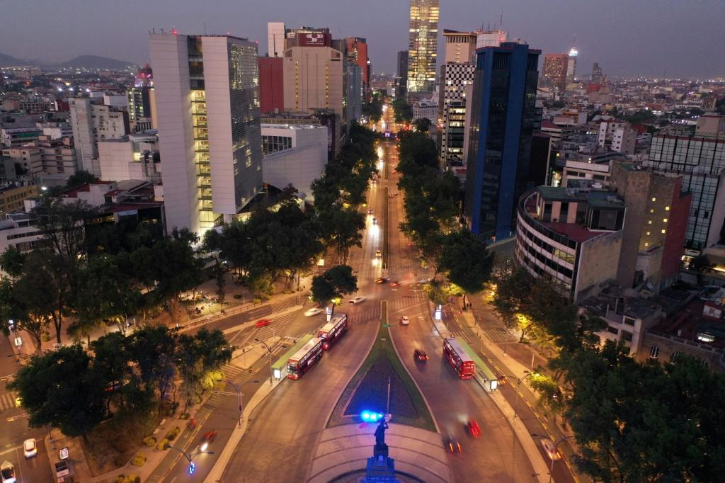 Light traffic travels on Mexico City's Reforma Avenue on March 23