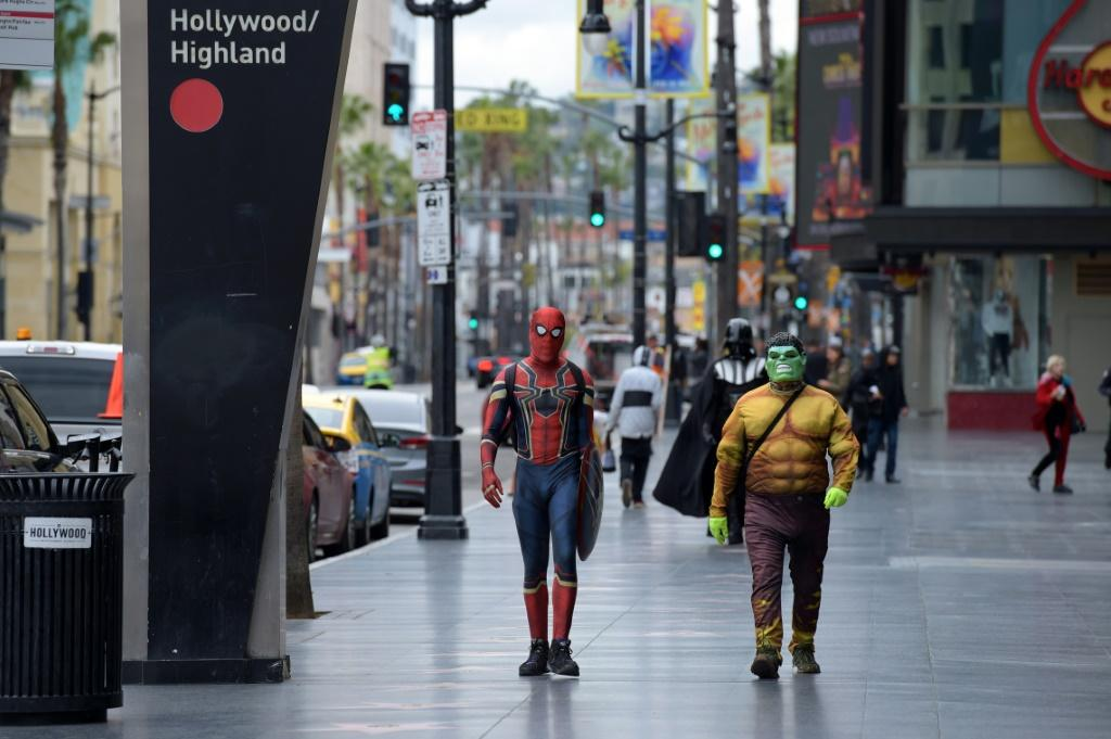 The Hollywood Walk of Fame lies deserted, with the final attempts to round up passengers for tours of the stars' homes and hangouts abandoned
