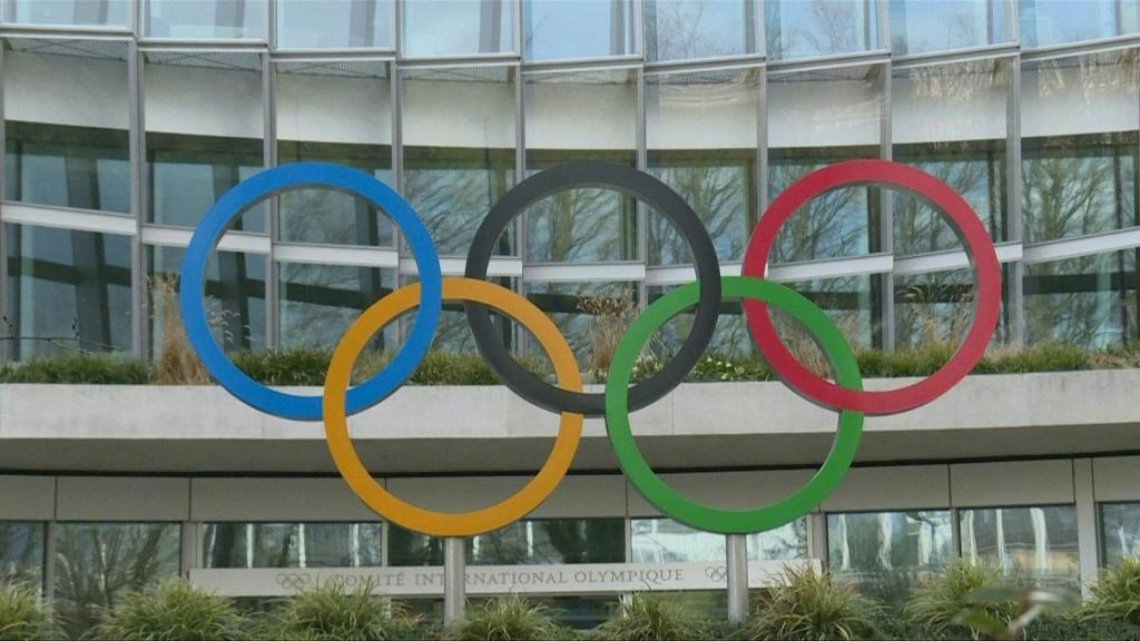 The postponed Tokyo 2020 Olympics will be held in around a year as a 'testament' to humanity's victory over the new coronavirus pandemic,says Japan's Prime Minister Shinzo Abe.