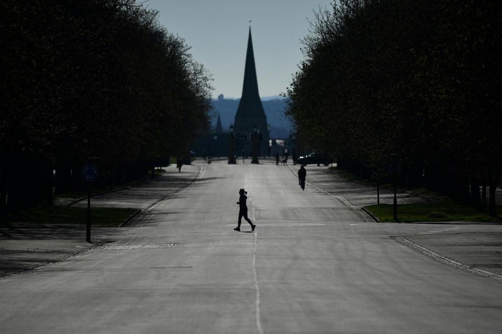 A runner exercises in Greenwich Park in south London