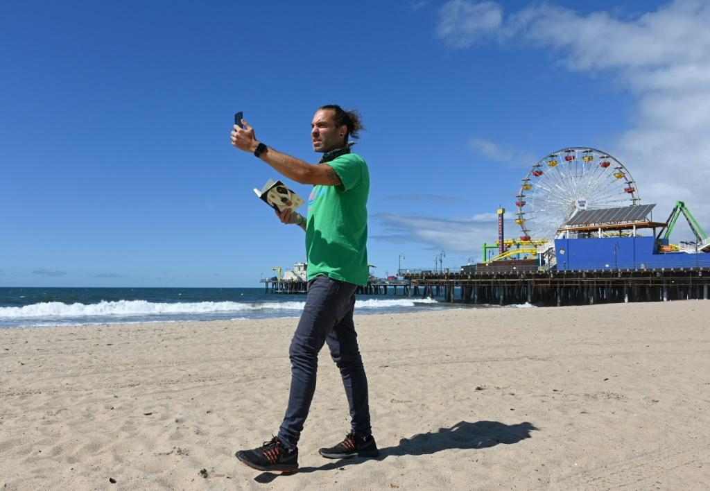 Adam Duford, owner of Surf City Tours, carries out virtual tours via his Instagram feed