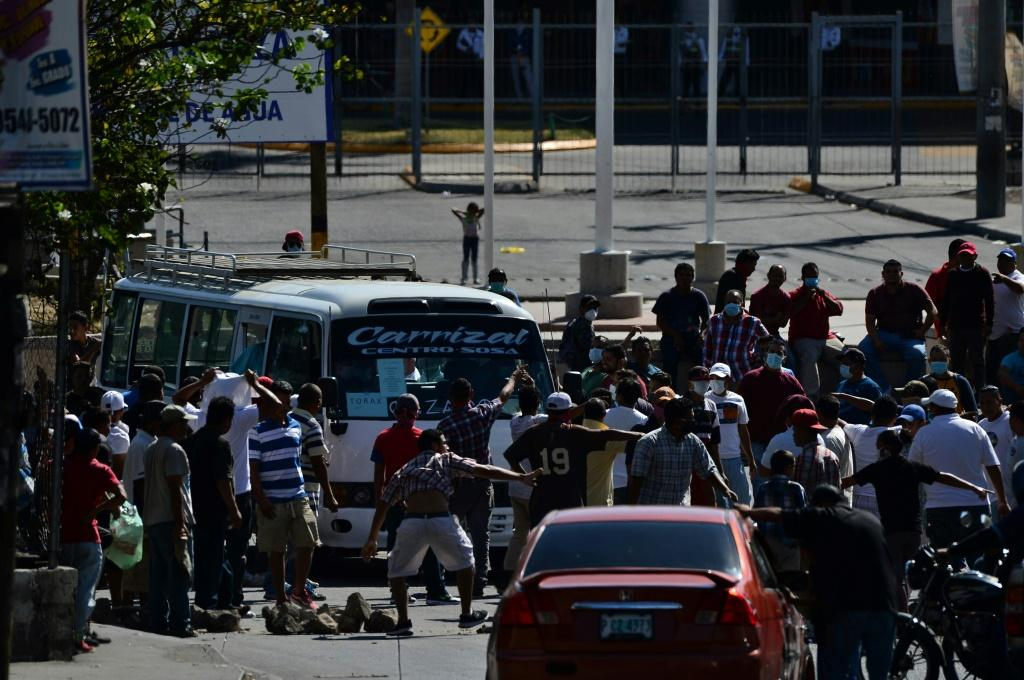 Hundreds of Hondurans took to the streets, demanding they be provided with food before the government-mandated curfew to curb the spread of the coronavirus went into effect