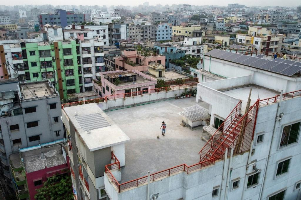 Nine-year-old Samin Sharar plays on the rooftop of his building in Dhaka