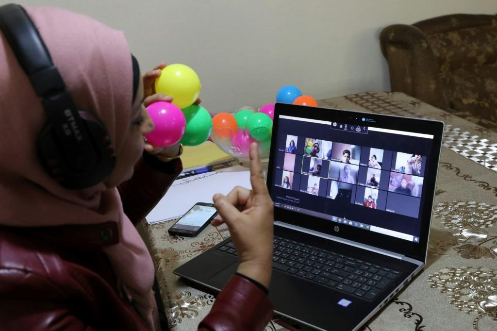 Palestinian teacher Jihad Abu Sharar conducts an online class from her home in the occupied West Bank