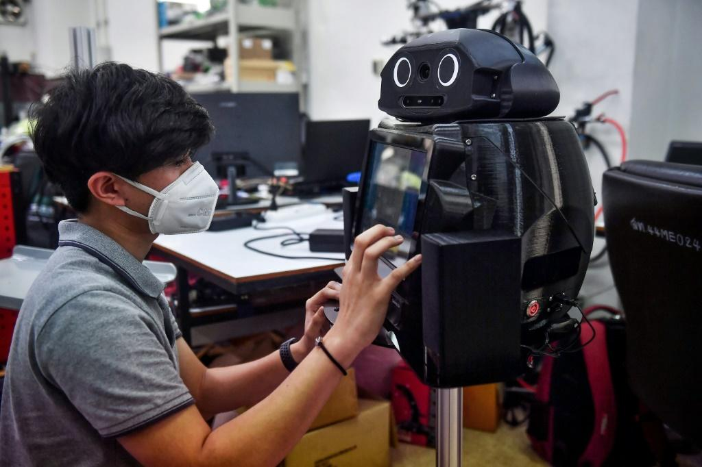 "Thai hospitals are deploying ""ninja"" robots to measure fevers and protect the health of overburdened medical workers on the frontlines of the coronavirus outbreak"