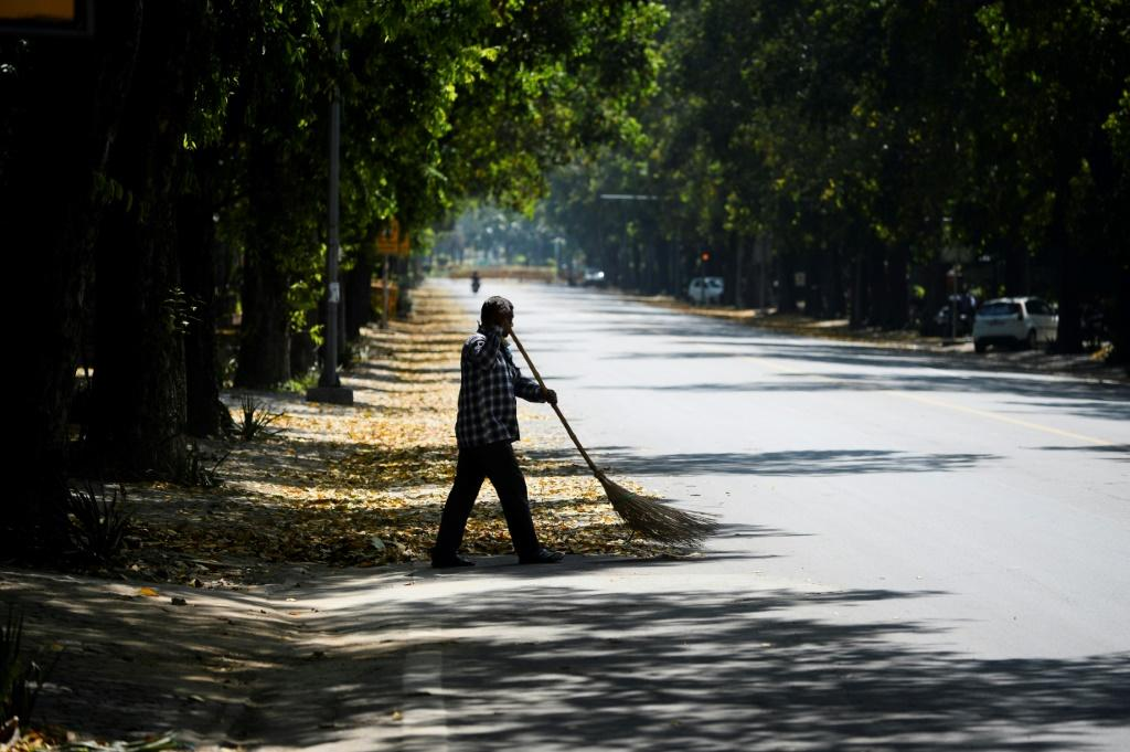 The normally-thronged streets of many Indian cities were all-but deserted after a government-mandated lockdown took effect