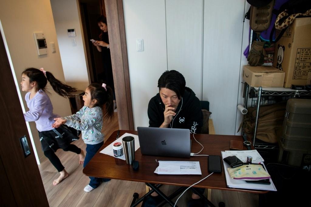 Working at home Yuki Sato, an employee of a startup company