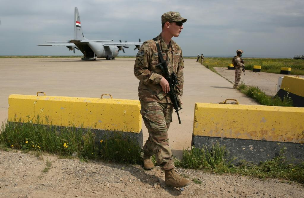 An American soldier walks at the Qayyarah air base ahead of a planned pullout by US-led forces