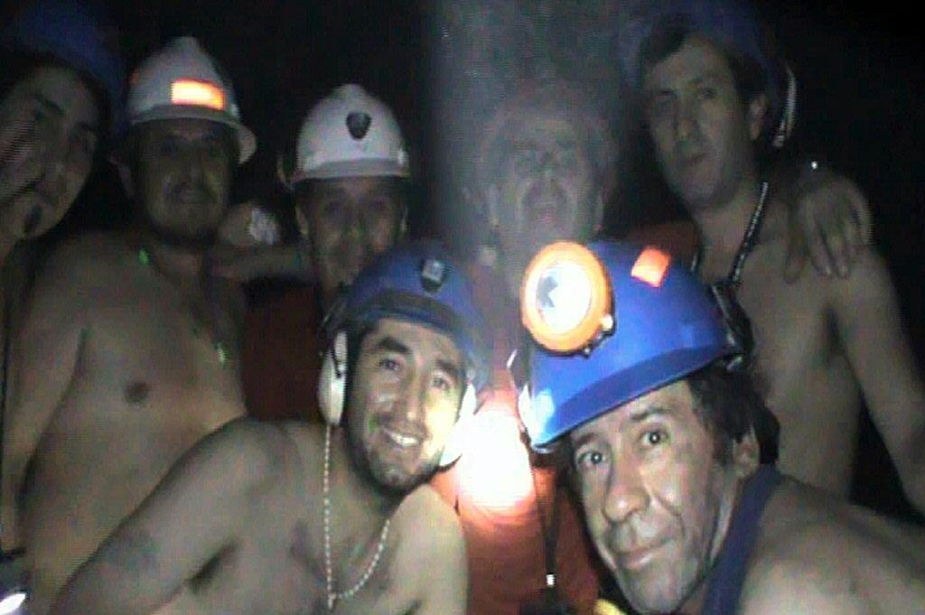 Trapped Chilean miners pose inside the San Jose Mine near Copiapo, 800 km north of Santiago, Chile in this file photo taken on September 17, 2010