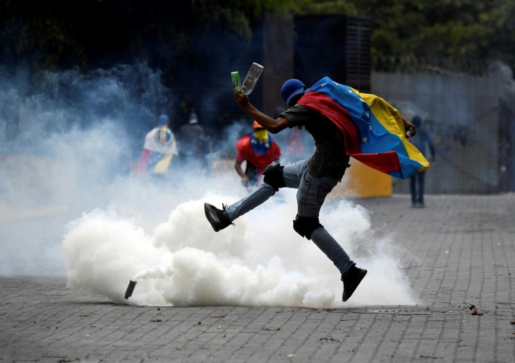 A supporter of Venezuelan opposition leader Juan Guaido is surrounded by tear gas shot by security forces in Caracas on March 10, 2020 -- despite US backing for more than a year, Guaido has failed to dislodge Maduro