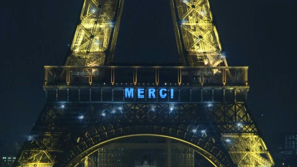 "IMAGES The Eiffel Tower pays tribute with a special light show spelling ""Merci"" to France's healthcare workers, who are on the frontline of the coronavirus fight."