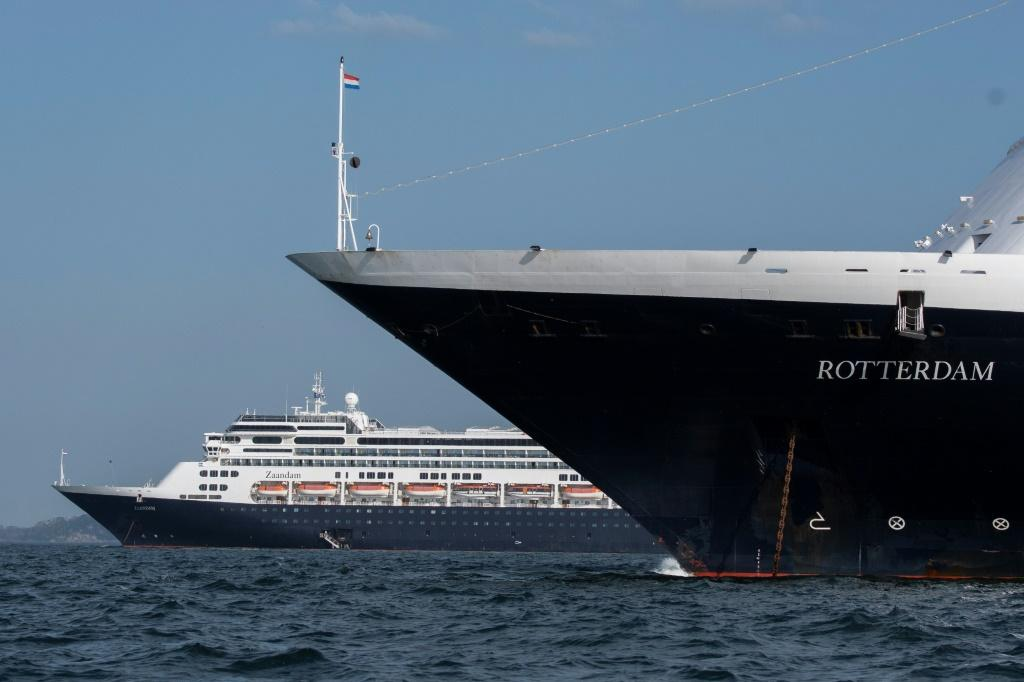 Holland America's cruise ship Zaandam (L) and the Rotterdam in Panama bay on March 28, 2020