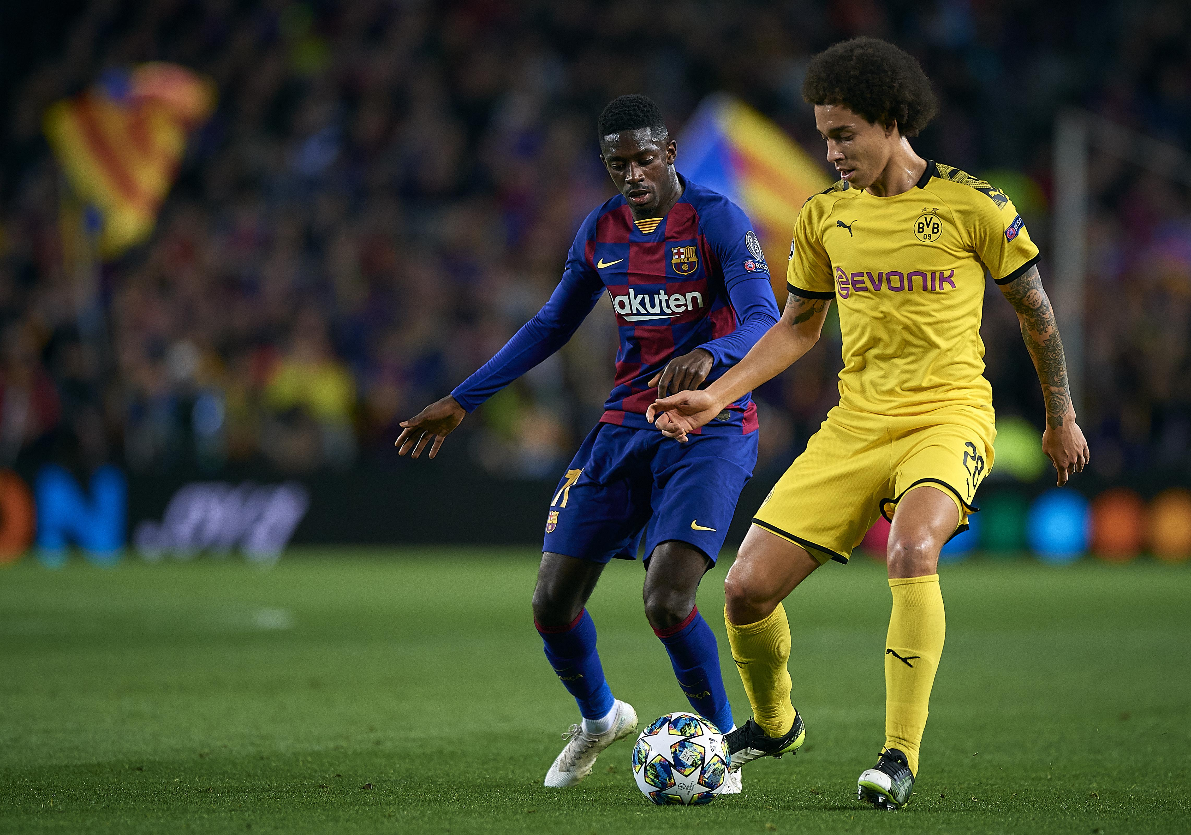 Ousmane Dembele (L) of Barcelona competes for the ball with Axel Witsel of Borussia Dortmund