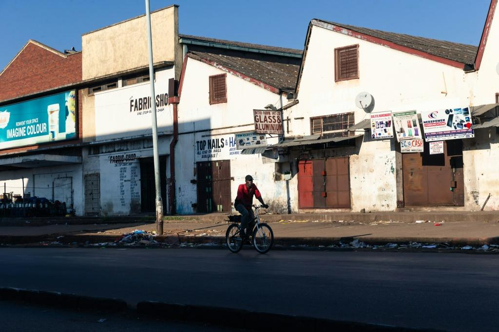 A lone cyclist makes his way in the usually bustling part of downtown Harare
