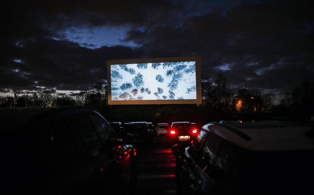 Cars pack a drive-in cinema in Essen, western Germany, after other cinemas were closed in an attempt to limit the spread of the coronavirus