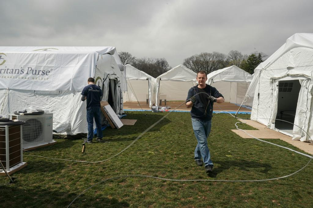 Volunteers set up an emergency field hospital in New York City's Central Park to help patients suffering from COVID-19