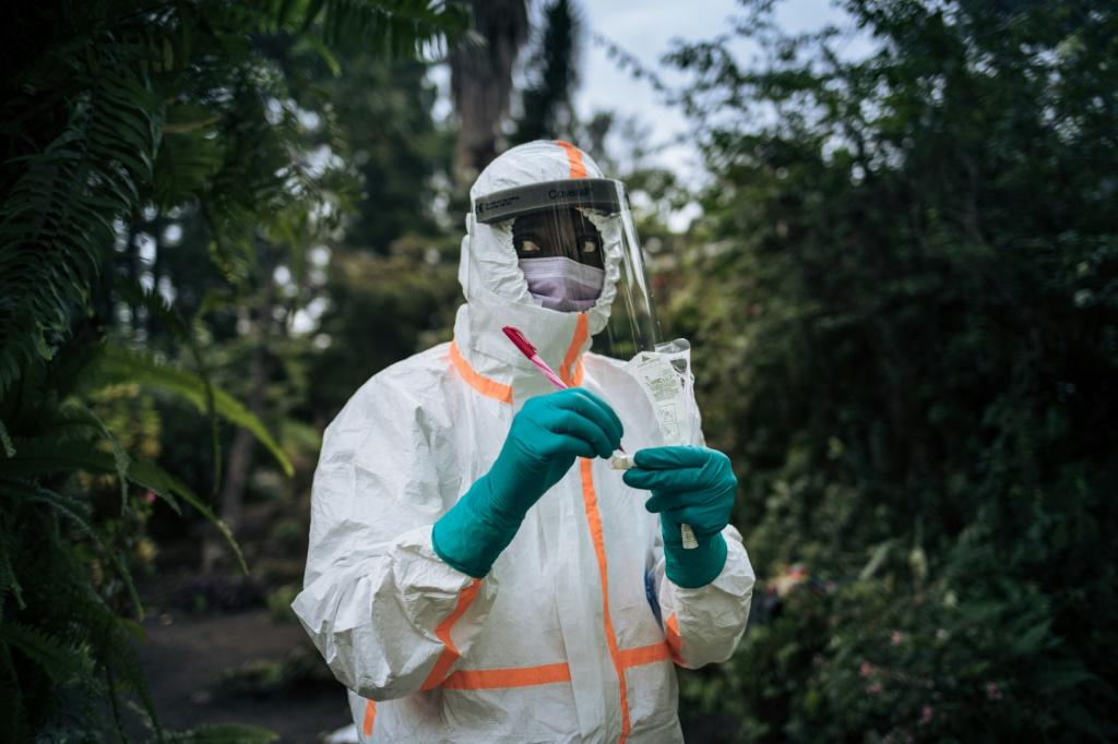 A staff member of the Congolese Ministry of Health prepares the sampling equipment to perform a COVID-19 test at a private residence in Goma, northeastern Democratic Republic of Congo