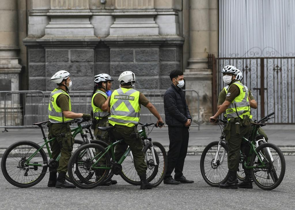 Chilean soldiers patrol in Santiago, Chile, before more than 1.3 million people in the city enter into total quarantine for a week