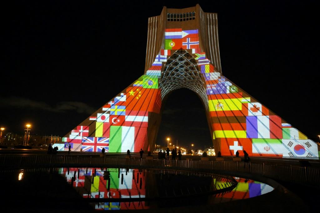 Iran's Azadi (Freedom) Tower is lit up with flags and messages of hope in solidarity with all the countries affected by the COVID-19 coronavirus pandemic