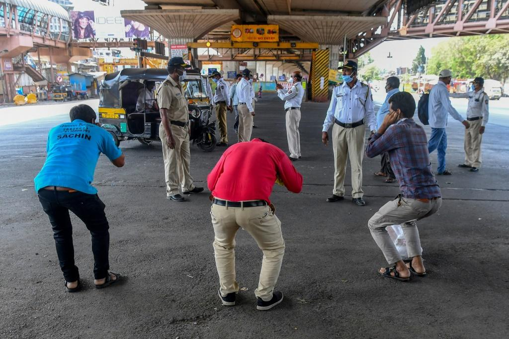 Mumbai police order people to do sit-ups as punishment for going out without a valid reason during a government-imposed nationwide lockdown in India