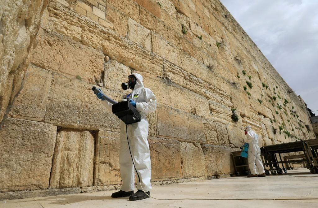 Workers sanitise the Western Wall, the most holy site where Jews can pray against the spread of the coronavirus COVID-19 in Jerusalem.