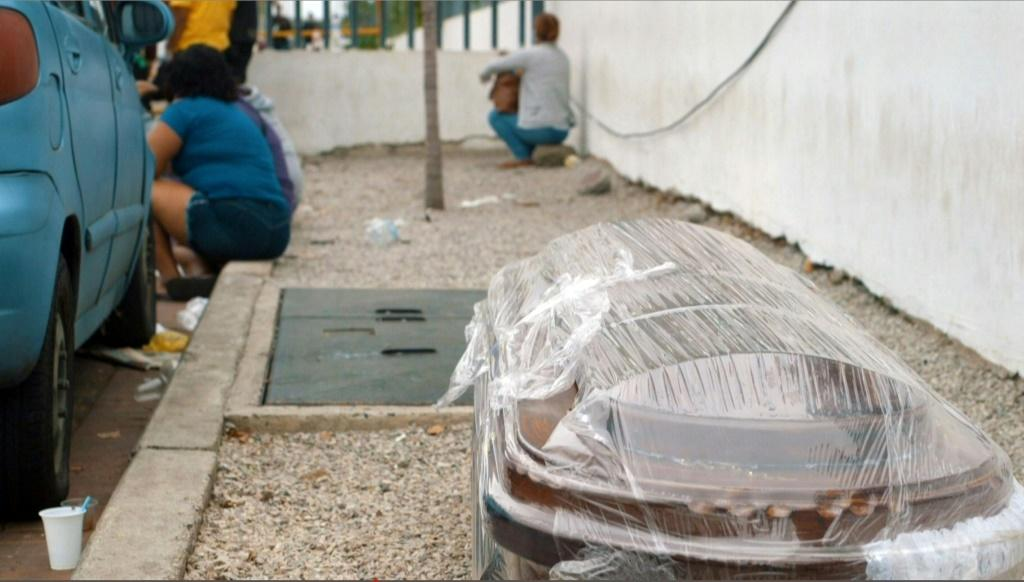 A coffin wrapped in plastic is seen outside a hospital in Guayaquil on April 1