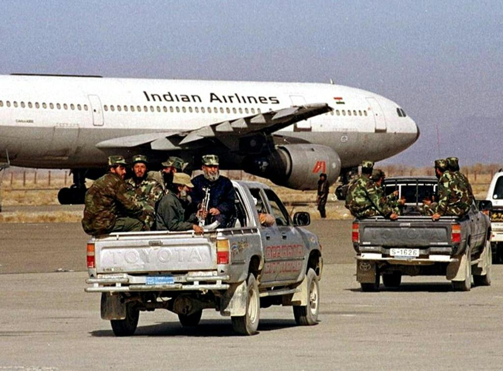 Afghan Taliban militia head towards a hijacked Indian Airlines plane in Kandahar in December 1999