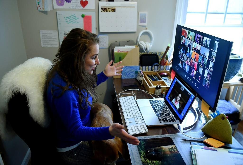 Lauryn Morley, a lower school substitute teacher for the Washington Waldorf School in Bethesda, Maryland, talks to a student on a Zoom conference