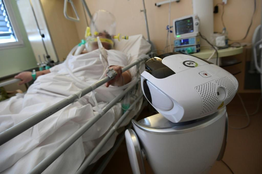 One of the six robots at the Circolo di Varese hospital in northern Italy checks up on a patient in the intensive care unit, helping medical staff reduce the risk of direct contact