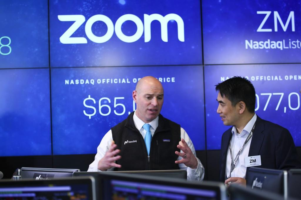 Zoom founder and CEO Eric Yuan (right) is seen at the Nasdaq market debut of the company in April 2019
