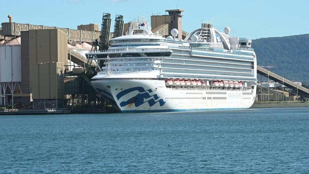 The Ruby Princess cruise ship sits docked at Port Kembla south of Sydney where it is expected to remain for several days after hundreds of crew showed symptoms of coronavirus. The local government hopes the days of quarantine and restocking at the port wi