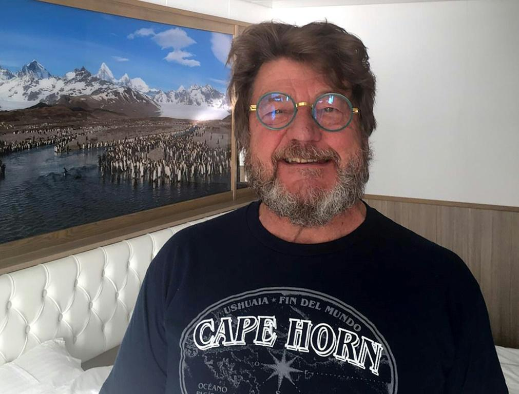 """Charley Nadin, 67, posing onboard the Australian cruise ship Greg Mortimer off the port of Montevideo, praised the """"extraordinary"""" care from local health authorities"""
