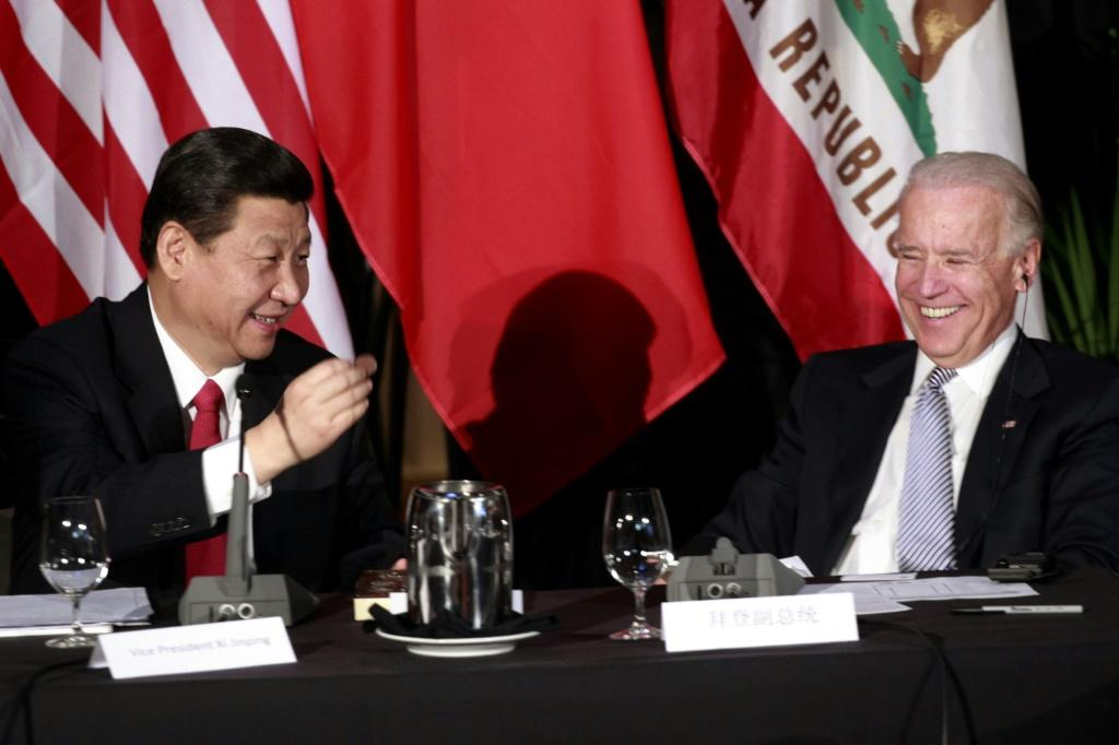 Xi Jinping shows Joe Biden a chocolate-covered macadamia nut presented to him at a 2012 meeting in Los Angeles when the two were both vice presidents