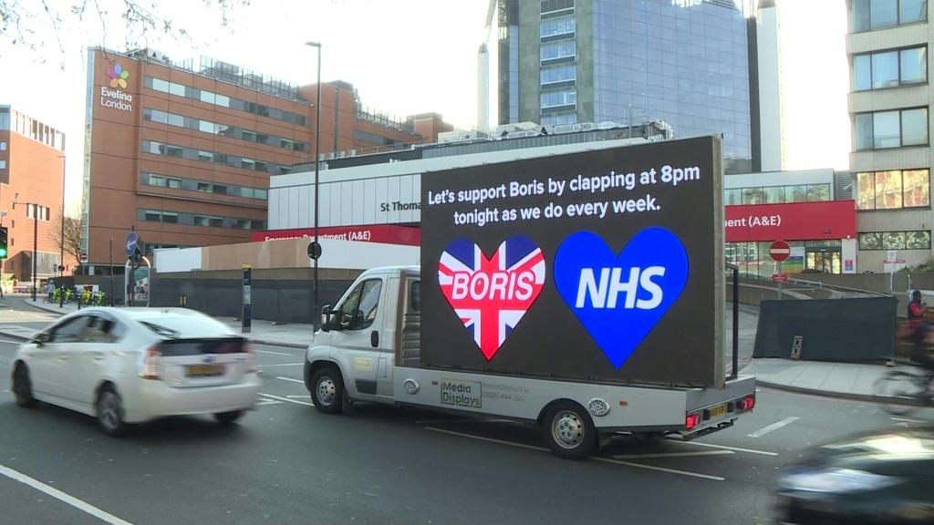 IMAGES A truck stationed outside London's St Thomas' Hospital displays messages of support for British Prime Minister Boris Johnson. Messages on its LED screen call on people to clap for him as he battles to make a recovery from COVID-19.