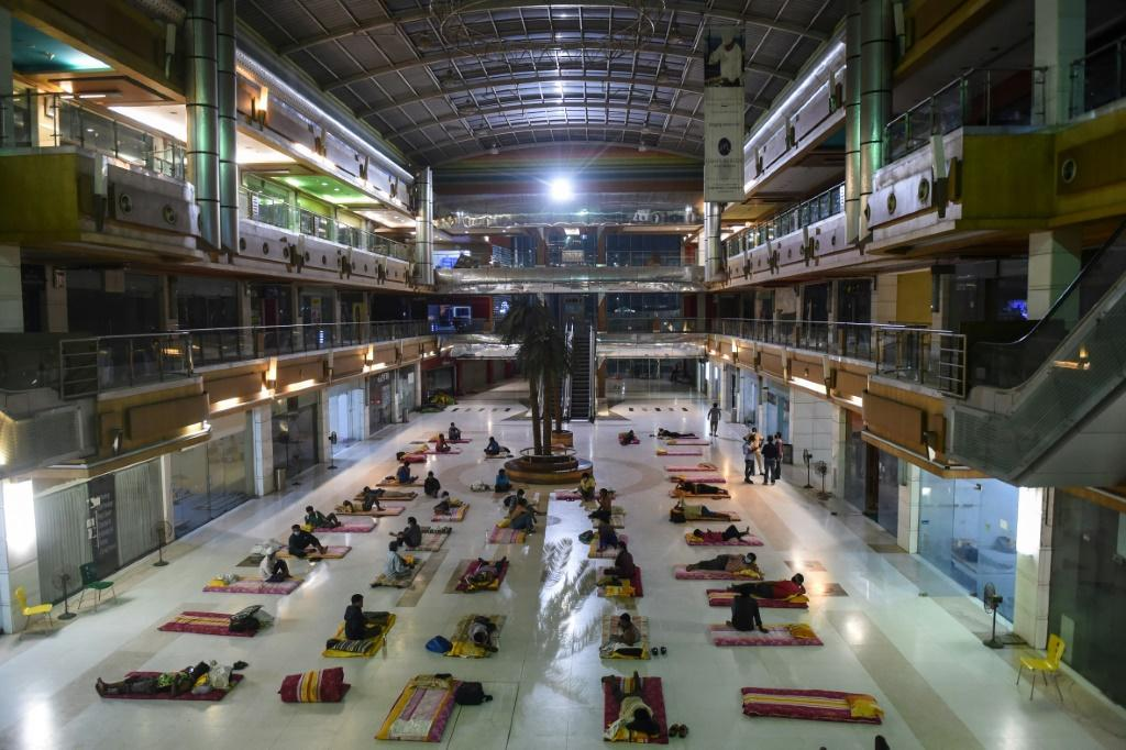 Migrant workers bed down at the shuttered JP Iscon mall in Ahmedabad, India