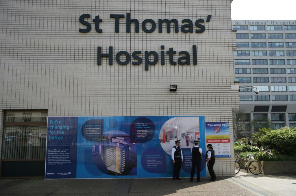 Police officers stand on duty outside St Thomas' Hospital