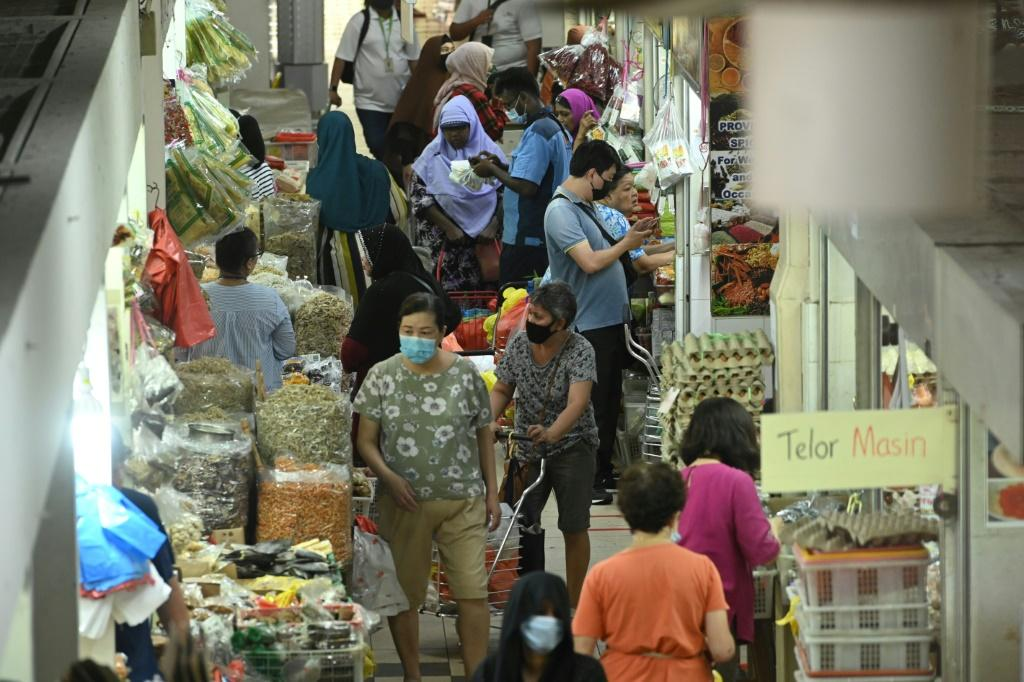 Shoppers in face masks mingle in the Geylang Serai market in Singapore