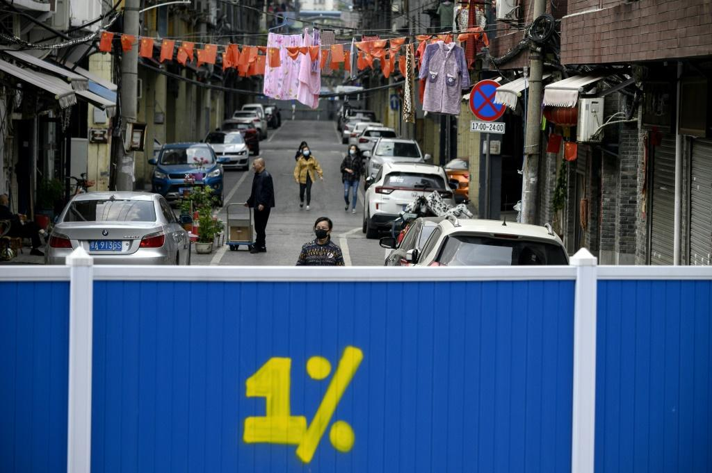 Some residential areas in Wuhan are still barricaded off to outsiders