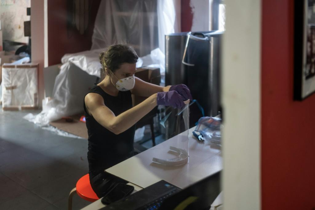 Luba Drozd makes protective shields for health workers in her apartment on her 3D printers, having raised money for supplies in a GoFundMe campaign