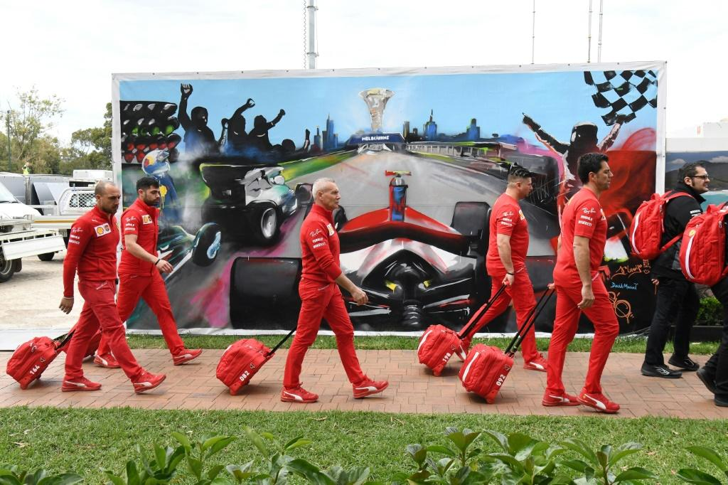 The Ferrari team prepares to leave the track after the cancellation of the Australian Grand Prix