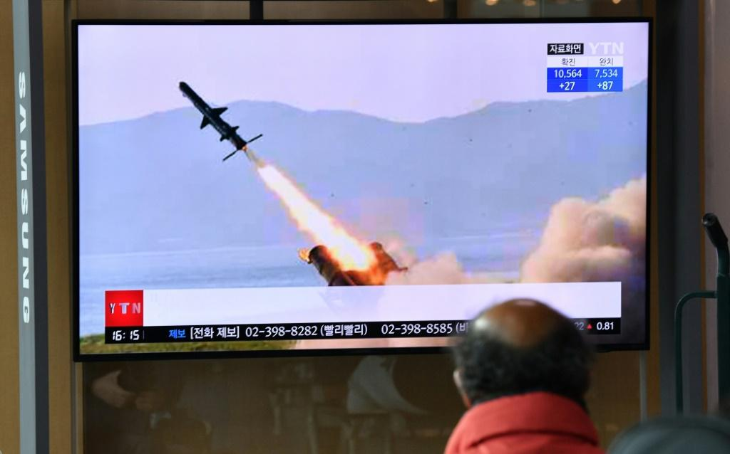 A man in a Seoul railway station watches a television broadcast on April 14, 2020, showing file footage of a North Korean missile test, after Pyongyang launched several suspected short-range cruise missiles toward the sea