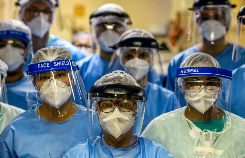 A group of doctors working with patients infected with the novel coronavirus COVID-19 wear face shields at the Intensive Care Unit of the Hospital de Clinicas in Porto Alegre, Brazil