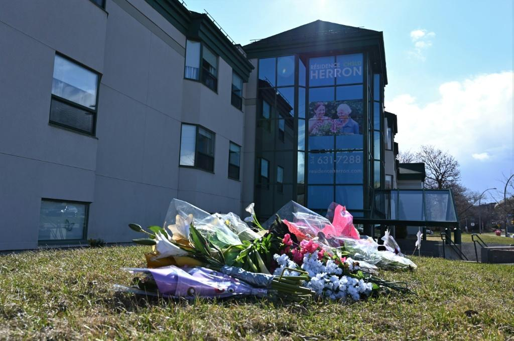 Flowers outside the Herron nursing home in the Montreal suburb of Dorval, where 31 deaths prompted an investigation for negligence after caregivers fled amid a coronavirus outbreak