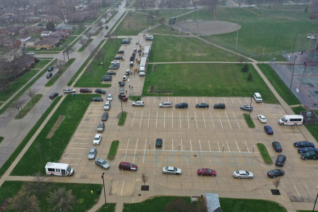 Cars line up at a food bank in Oak Park, Michigan