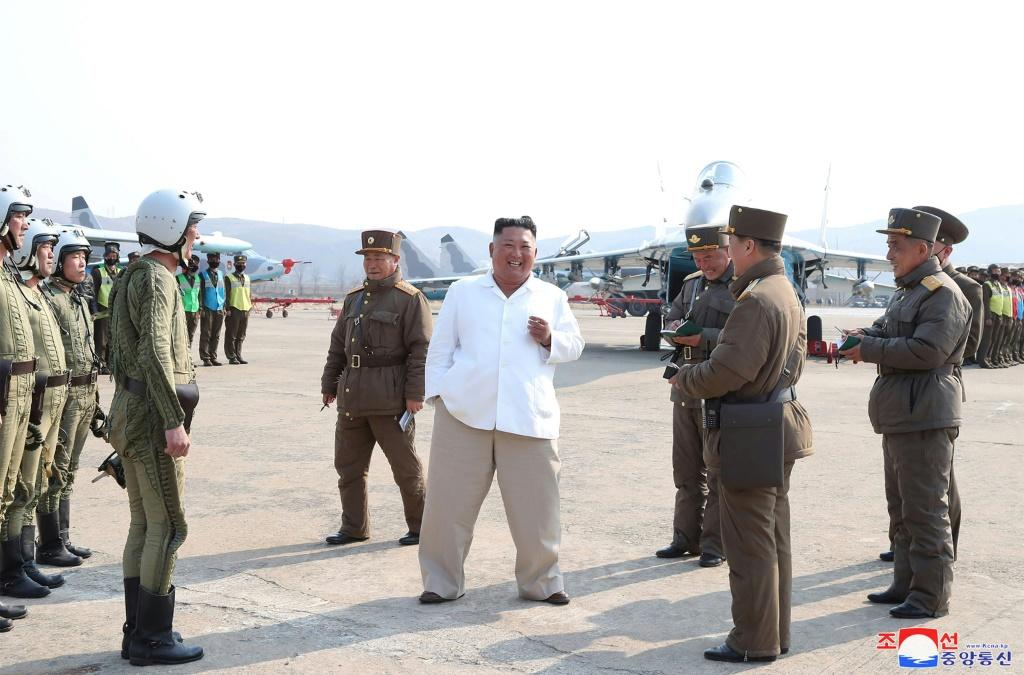 The health of Kim Jong Un, pictured center in an image released on April 12, 2020, is frequently the subject of speculation, but little concrete is known about the secretive leader