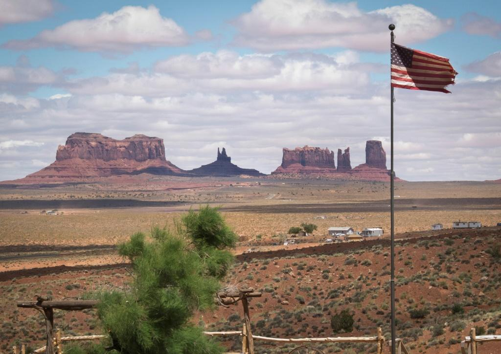 Rock formations are seen behind the American flag at Gouldings Lodge and Trading Post in Monument Valley Navajo Tribal park, Utah, in 2014