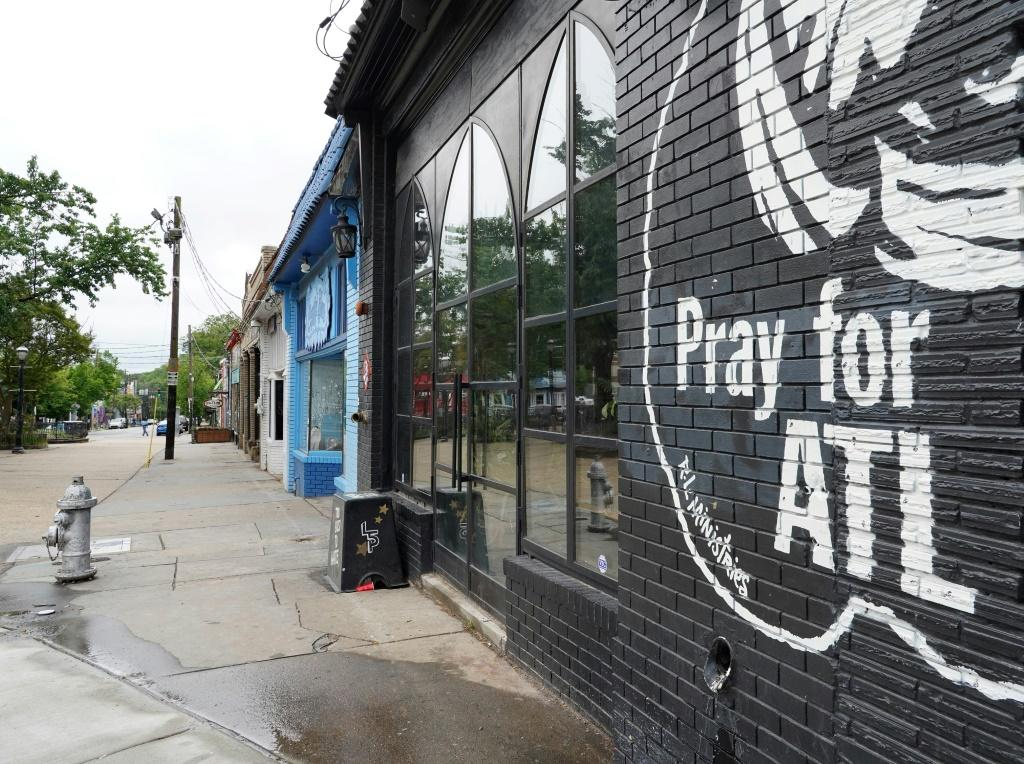 A sign stating Pray For Atlanta is seen on the side of a restaurant in the Georgia capital as it prepares to ease a coronavirus shutdown