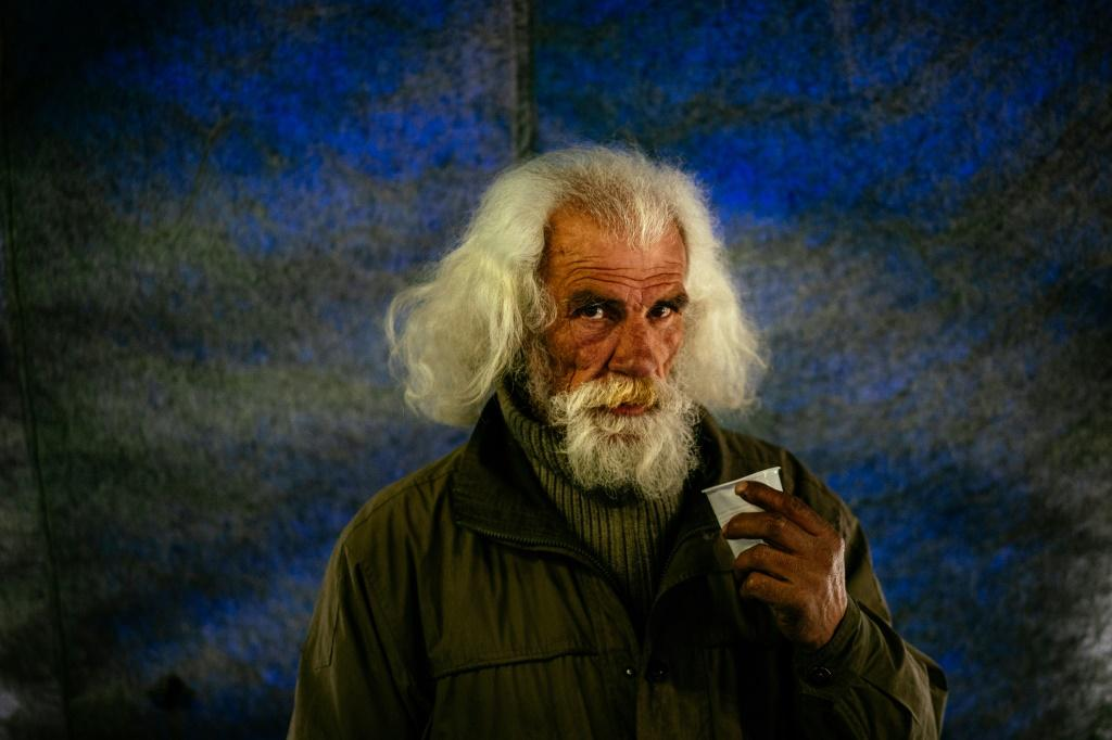 """A homeless man in Moscow gets a meal at s has a meal at the """"Rescue Hangar"""" during the COVID-19 coronavirus lockdown"""