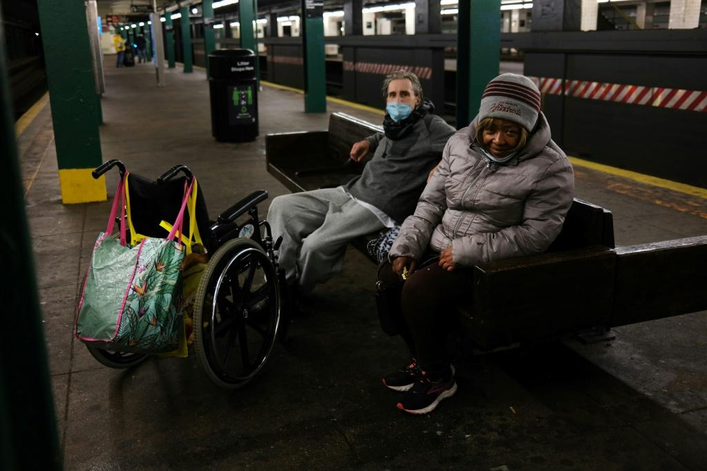 Homeless people take shelter at a New York subway station on April 13